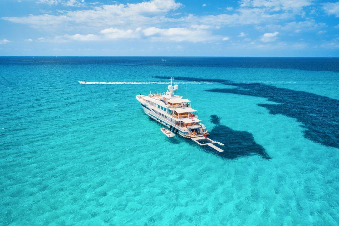 Yacht on the azure seashore in balearic islands